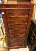 A 1980s burr yew veneered gun cabinet as a wellington chest with compliant locking systems, six