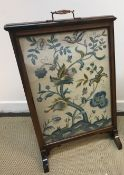 A circa 1900 rosewood framed fire screen with silk needlework panel of stag and blossoming tree (