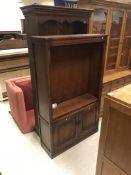 A modern mahogany bookcase cabinet with three glaz
