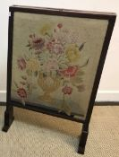 A 19th Century Scottish mahogany framed fire screen with adjustable side panels and top panel, the