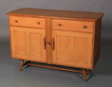 Ercol, a pale elm sideboard, c.1955/60 two frieze drawers above two twin indented panel cupboard