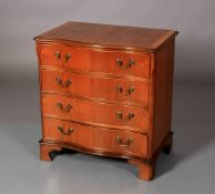 A George III style mahogany crossbanded serpentine chest of four long graduated drawers with brass