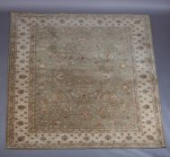 A Zeigler style carpet in pale olive within an ivory main border, 261cm x 351cm