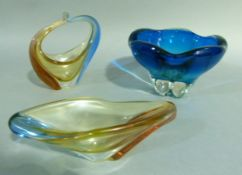 Blue and clear cased glass bowl with wavy rim, 15cm high; together with an elongated bowl and basket