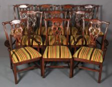 A set of ten hardwood dining chairs of mid 18th century design, having a striped velvet and flat