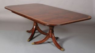 A Jonathan Charles figured mahogany crossbanded and boxwood banded dining table of Regency design,