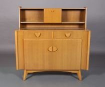 Nathan Products c.1955/60s a beech veneer sideboard raised back with central cupboard and open