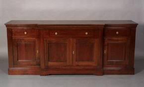 A Grange French cherrywood breakfront side cabinet, having one long central drawer flanked by a
