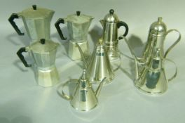 A collection of three steel coffee pots and four percolators