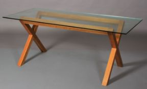 A pale elm and glass top dining table, rectangular on 'x' refectory supports, 180cm wide x 82cm deep
