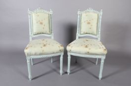 A pair of French style pale blue single chairs, the arched top rail with carved ribbon cresting,