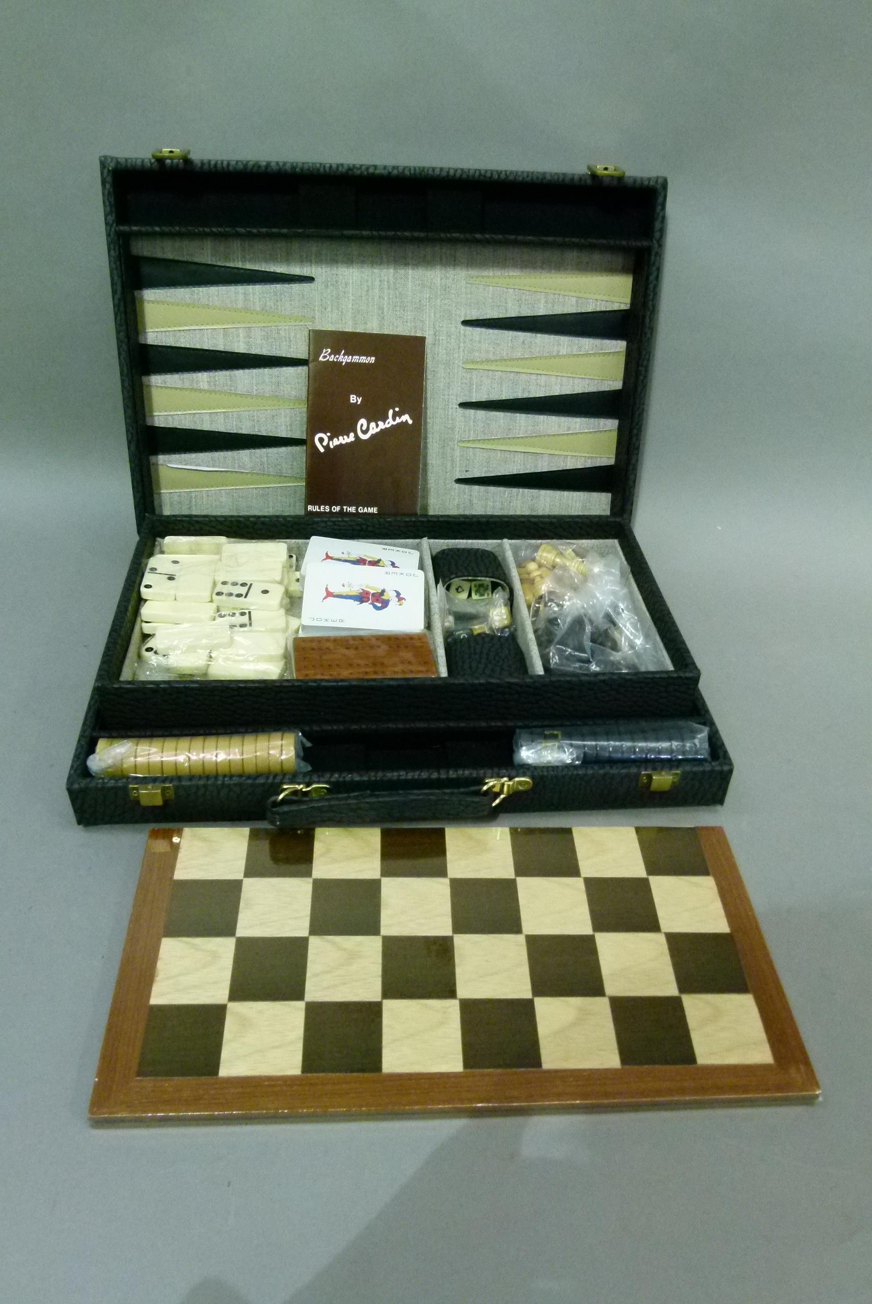 A games compendium comprising backgammon board, checkers board, dominos, cards, cribbage, dice and