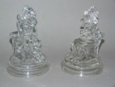 A pair of moulded glass figures of Punch and Judy, the bases moulded with J P and anchor mark, 17.