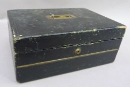 A Victorian black leather and brass writing box having an inset handle to the cover, the interior