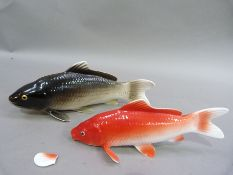 A Noritake bone china figure of a carp 13.5cm long; together with another similar, the latter with