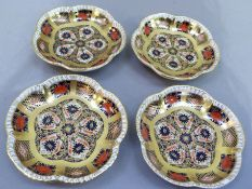 A set of four Royal Crown Derby pattern 1128 shaped circular pin trays, 11.5cm wide