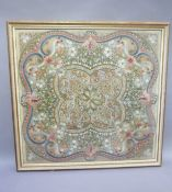 A needlework panel circa 1900, worked in rose, blue, green, with fruiting branches, blossom and