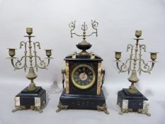 A late Victorian black slate and inlaid marble clock garniture, the clock with ornate finial,