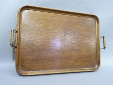 An Edwardian oak and brass two handled tray 67cm over handle x 42cm