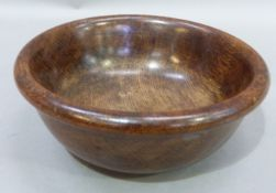 A turned oak bowl, 25 cm diameter by 10cm high