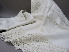 A pair of white embroidered, lace inset and fringed bedspreads, single size, 176cm x 254cm approx