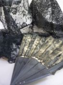 A Victorian blue lace over cream fan with ebonised sticks together with black mantilla lace (3)