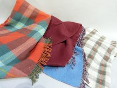 A green, red and oatmeal plaid knee rug and two others (faults)