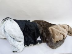 A Motorlux car rug in black and grey with reversible fake fur, together with another similar in