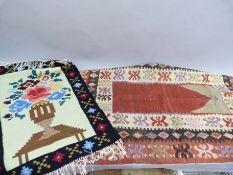 A Kilim prayer mat in fox red, ivory and black with triple border, 129cm x 90cm; together with a