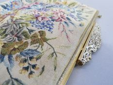 A Petit Point evening bag, of floral design, gilt metal frame, pierced clasp and gilt metal chain,