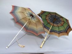 A vintage rainbow coloured rayon parasol, the cream shaft with spherical finial painted with a