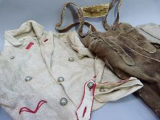 A gentleman's traditional Austrian outfit circa 1930's of lederhosen with braces and a linen