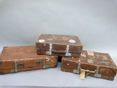 Three Revelation suitcases including a leather suitcase with labels for Durban, Dolomiti,