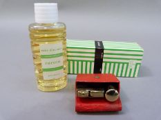 A lady's 19th century Consul Amor lighter and lipstick set in red leather case together with a