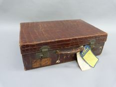 An early 20th century crocodile skin suitcase by Arthur Barber of Bradford, the interior lined in