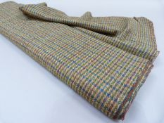 A length of Harris Tweed in blue, red and green stripe on camel ground