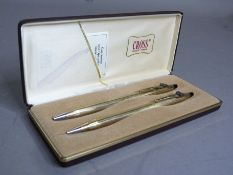 A gilt metal Cross ball point pen and retractable pencil in original box