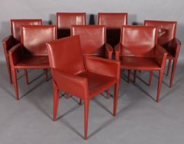 FRAG, ITALY, a set of eight fox red leather dining chairs on tapered legs, six low backs
