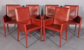 FRAG, ITALY, a set of six fox red leather high back dining chairs, on tapered legs