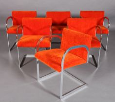 A SET OF SIX ITALIAN CHROMIUM PLATED STEEL CANTILEVER DINING CHAIRS, c.1970, with arch-profile arms,