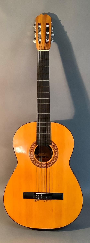 An Admira Almeria classical guitar with Oregon pine top and Sapelli back, ebonized finger plate
