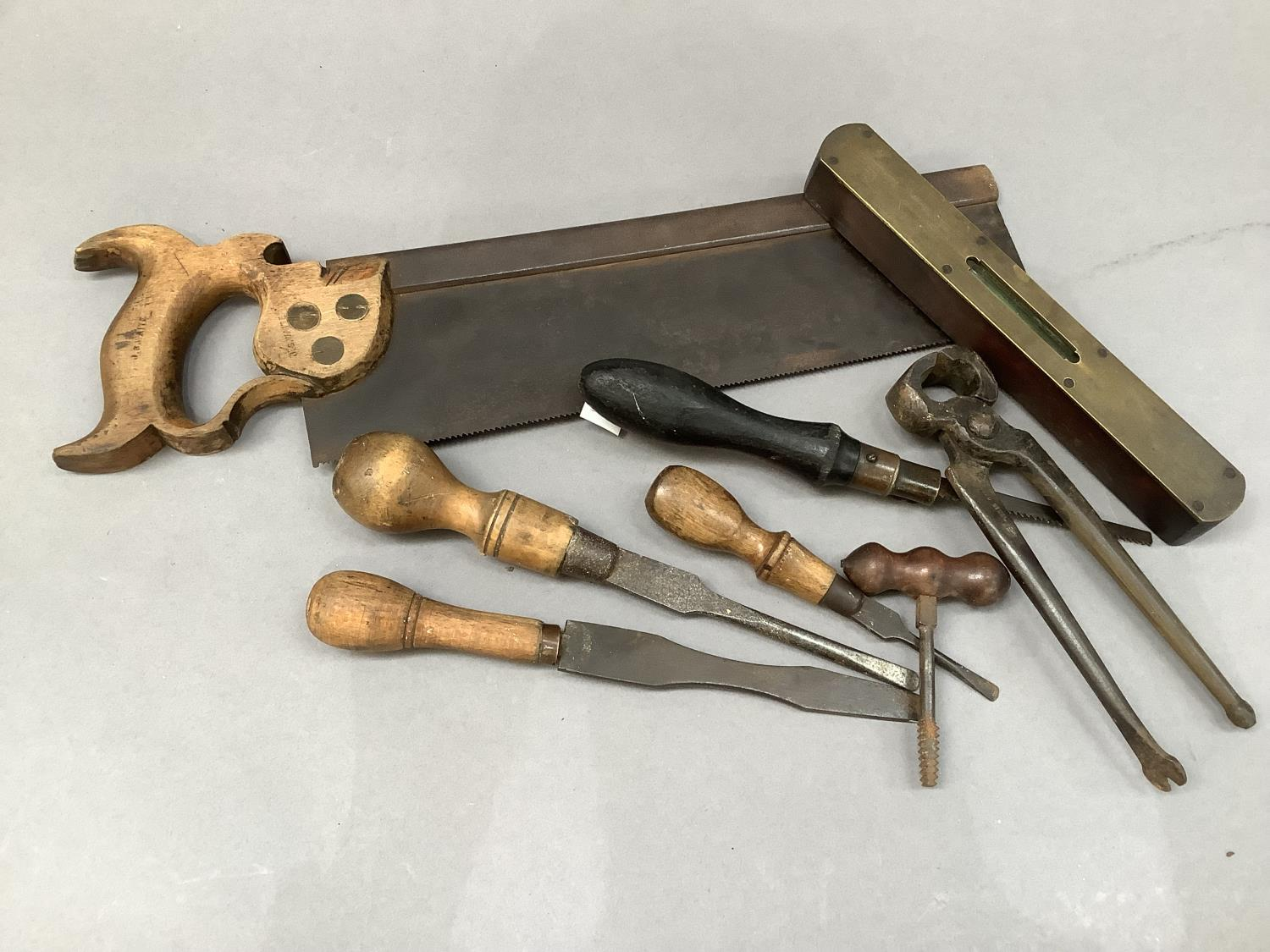 A quantity of vintage hand tools including saw, pliers, screwdrivers, level and hammer - Image 2 of 3