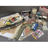 A quantity of craft material to include watercolours, modelling accessories, glitter, beads, paints,
