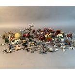 A quantity of Britain's farm animals, fencing, blacksmith, hen coop, hayrick, cart, etc (quantity)