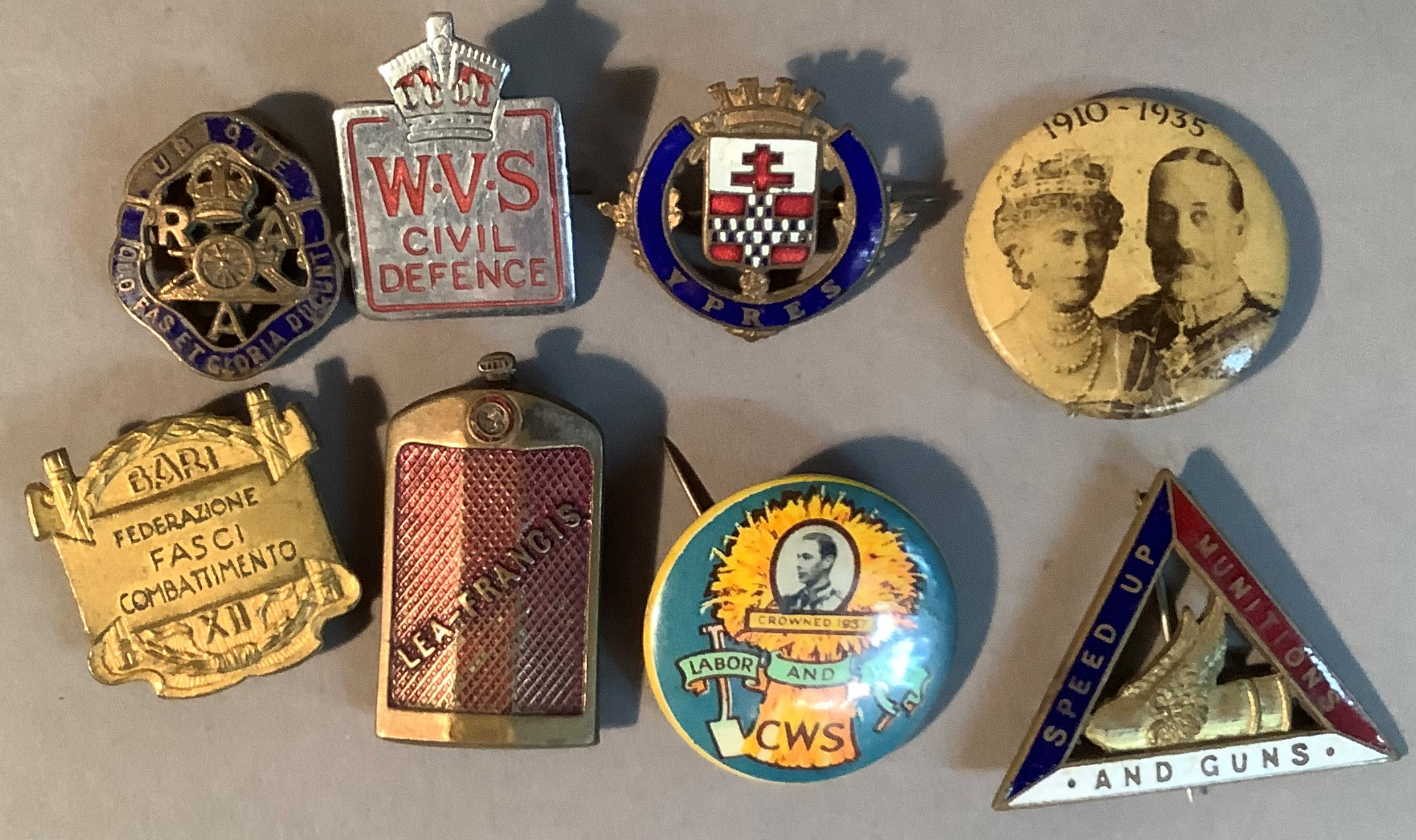 Eight various badges to include WVS Civil Defence, Lea-Francis, 1910-1935 Royal Badge, CWS Labour