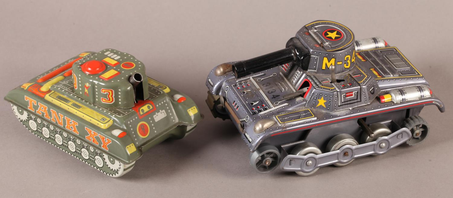 A Vintage Modern Toys (Japan) printed tinplate clockwork M-34 tank, the turret with hinged lid,