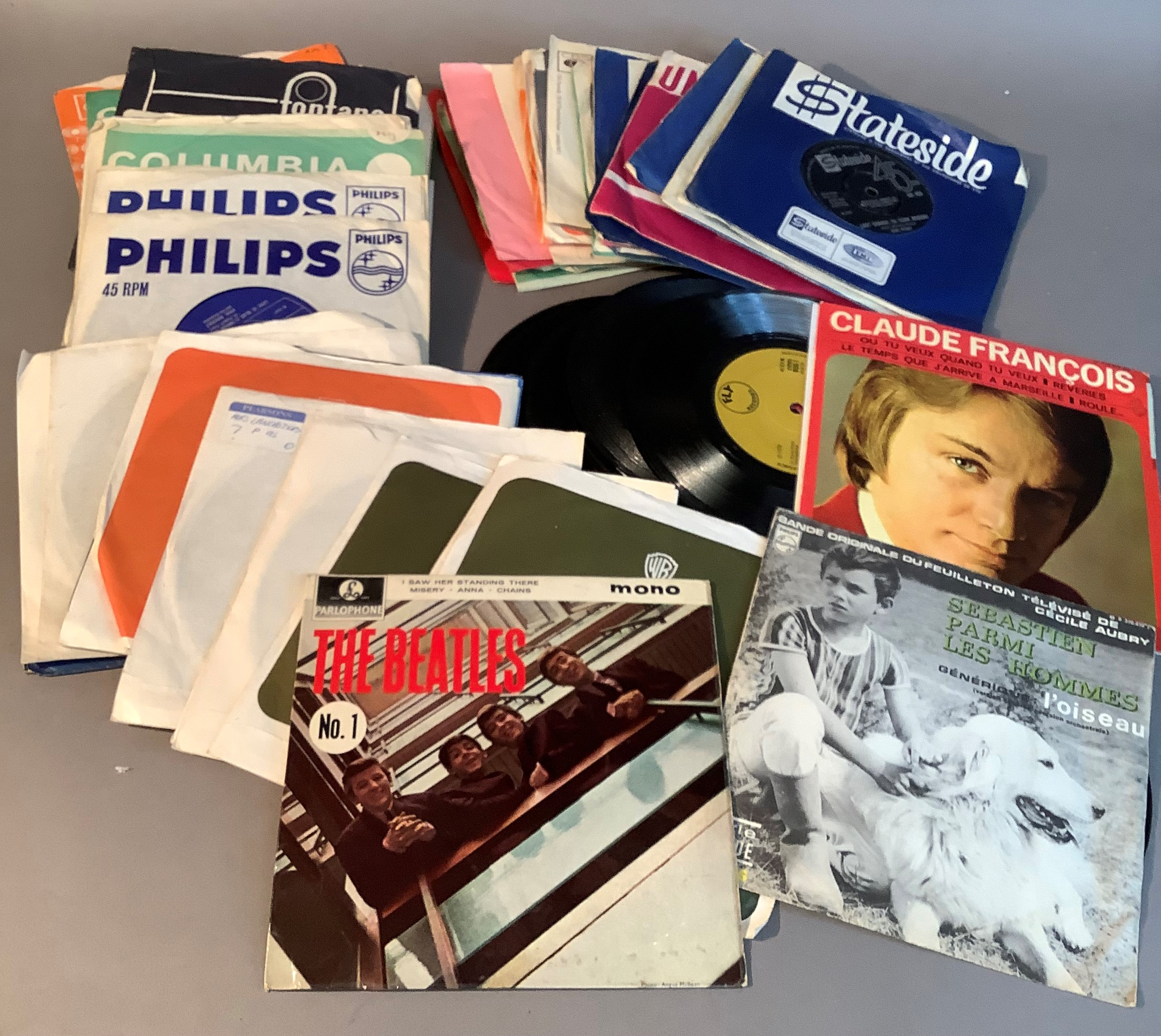 A quantity of 45rpm records to include: The Beatles - I saw her standing there, first published