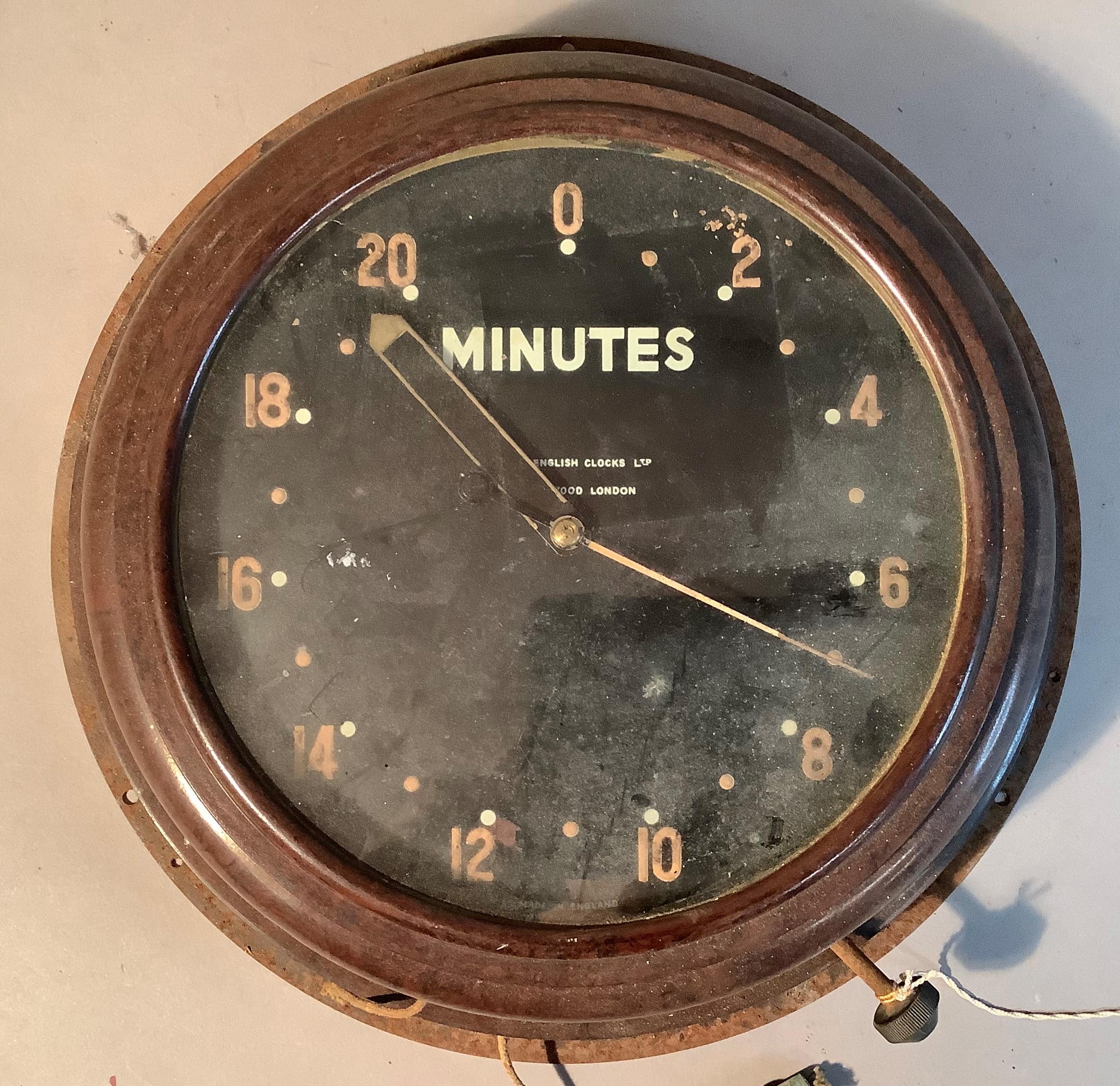 A dark room clock circa 1940 by Smith in brown Bakelite case, approximate diameter 30cm