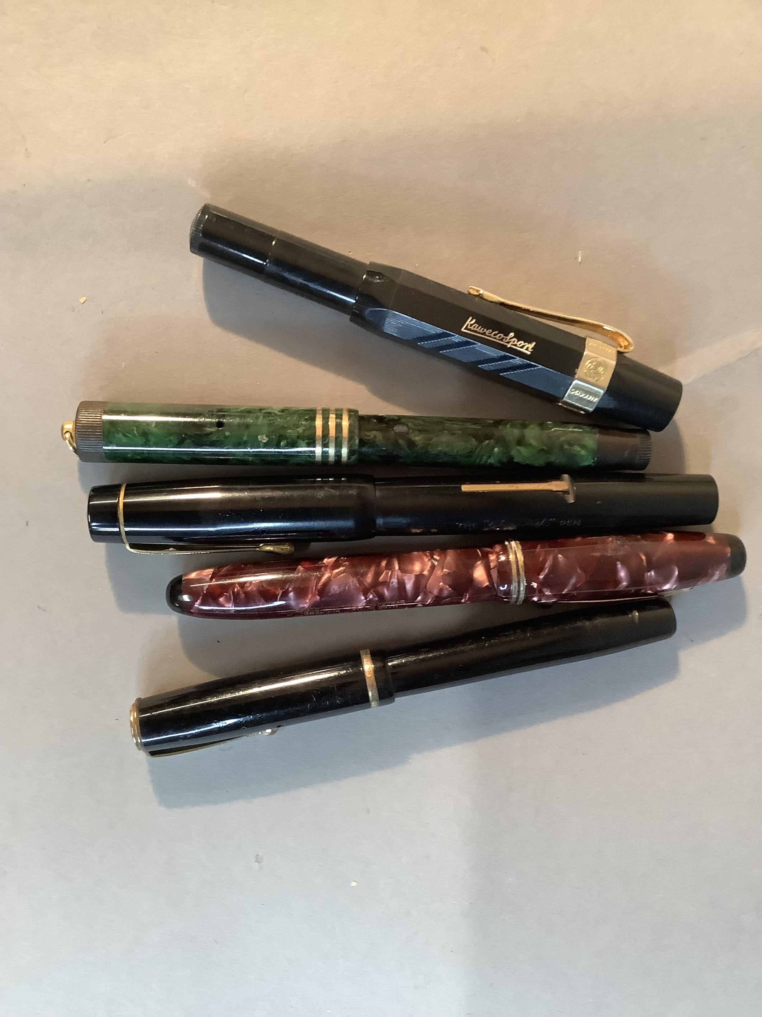 A Parker Parkette fountain pen, pink marbled case, lever fill, No.25 nib; Parker Moderne, black