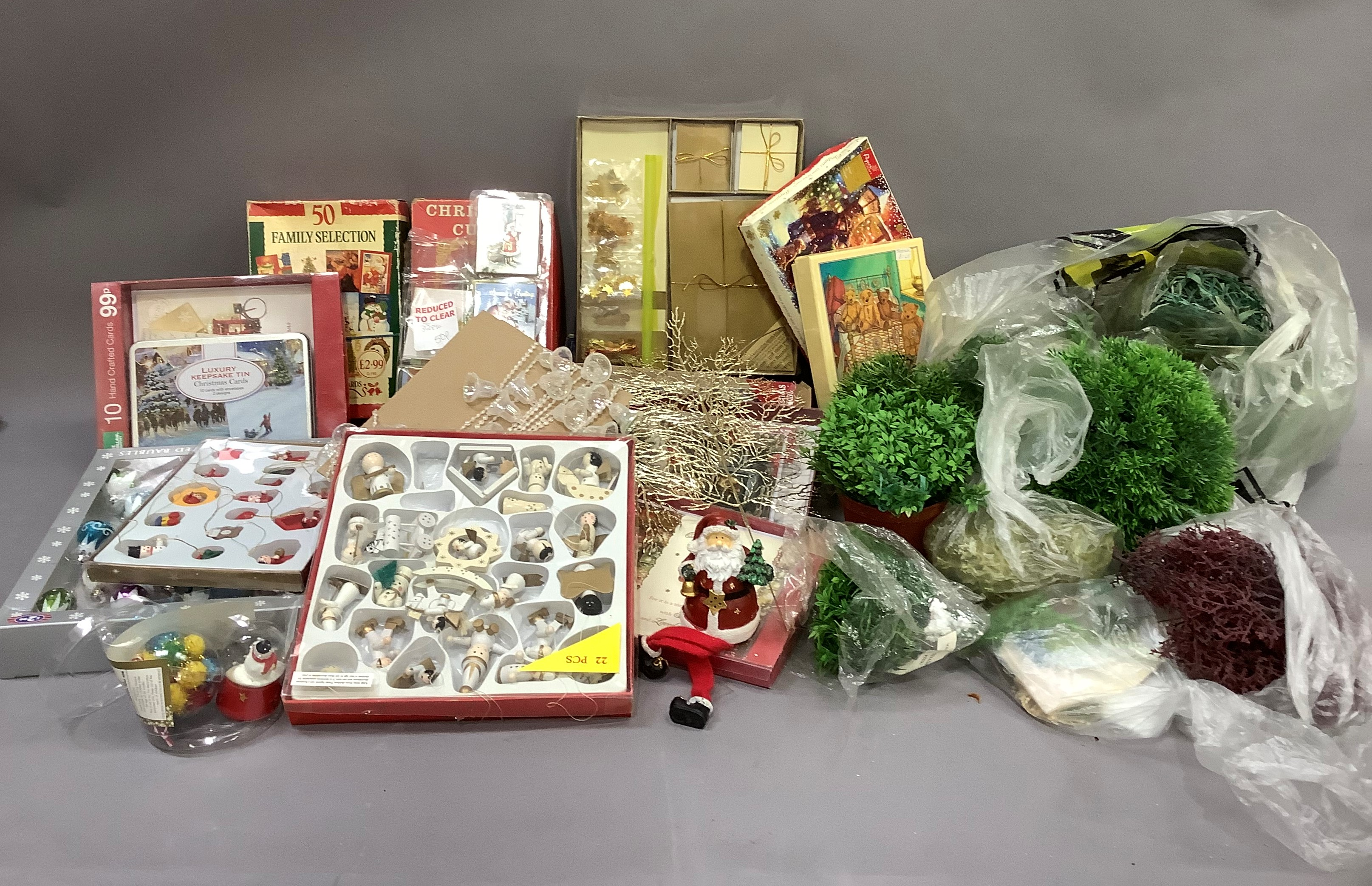 A quantity of Christmas cards, Christmas decorations, cotton reels, etc